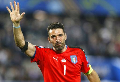 FILE - In this Saturday, July 2, 2016 file photo, Italy goalkeeper Gianluigi Buffon waves as he leaves the pitch after losing the Euro 2016 quarterfinal soccer match between Germany and Italy, at the Nouveau Stade in Bordeaux, France. Juventus captain Gianluigi Buffon has announced he is leaving the Italian club but the goalkeeper could continue playing elsewhere. Buffon, who is widely regarded as one of the best goalkeepers of all time, was expected to announce his retirement at a press conference at Allianz Stadium on Thursday, May 17, 2018.