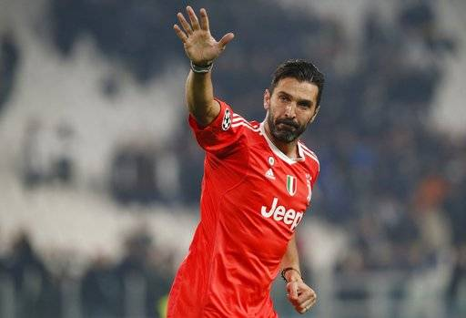 FILE - In this Wednesday, Nov. 22, 2017 filer, Juventus goalkeeper Gianluigi Buffon waves to fans at the end of the Champions League group D soccer match between Juventus and Barcelona, at the Allianz Stadium in Turin, Italy. Juventus captain Gianluigi Buffon has announced he is leaving the Italian club but the goalkeeper could continue playing elsewhere. Buffon, who is widely regarded as one of the best goalkeepers of all time, was expected to announce his retirement at a press conference at Allianz Stadium on Thursday, May 17, 2018.