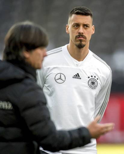 File -- In this Monday, March 26, 2018 photo Germany's head coach Joachim Loew, left, and player Sandro Wagner, right, attend a training session of the German national soccer team in Berlin, Germany. (Thomas Eisenhuth/dpa via AP, file)