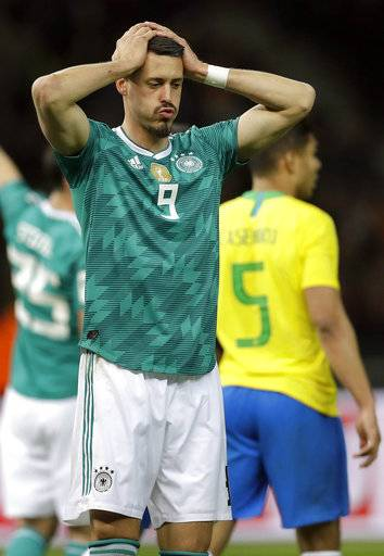 File -- In this Tuesday, March 27, 2018 photo Germany's Sandro Wagner reacts during the international friendly soccer match between Germany and Brazil in Berlin, Germany. Brazil defeated Germany by 1-0.