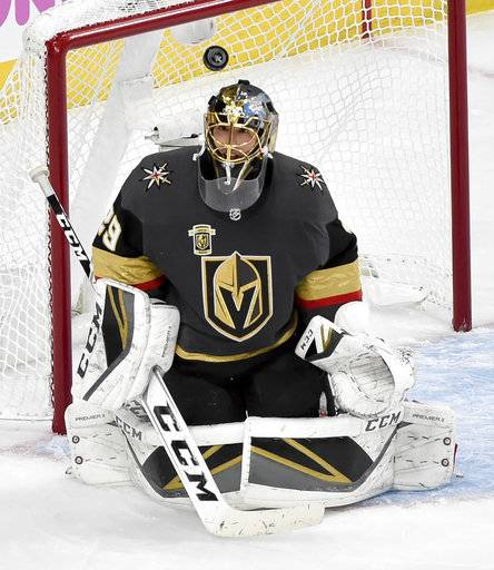 Vegas Golden Knights goaltender Marc-Andre Fleury makes a save against the Winnipeg Jets during the second period of Game 3 of the NHL hockey playoffs Western Conference finals Wednesday, May 16, 2018, in Las Vegas.