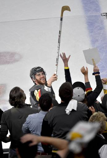 Vegas Golden Knights center Jonathan Marchessault gives away a stick after the team's 4-2 win against the Winnipeg Jets during Game 3 of the NHL hockey playoffs Western Conference finals Wednesday, May 16, 2018, in Las Vegas.