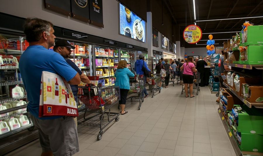 Lines for the checkout snaked around the back of the new Aldi store Friday in Naperville.