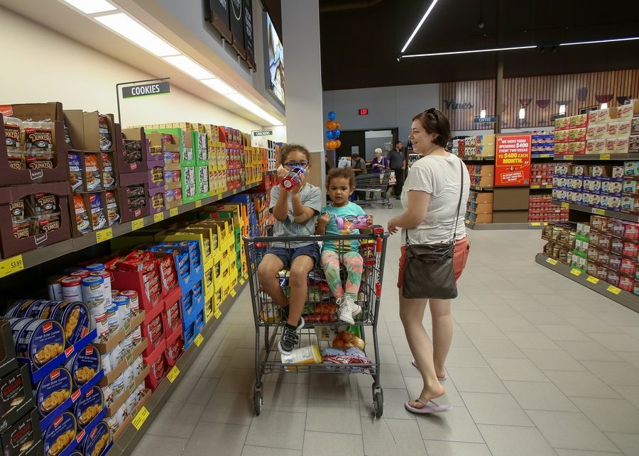Cassie Gillespie shops at the new Aldi store in Naperville on Friday with her kids, Marshall, 5, and Billie, 2.