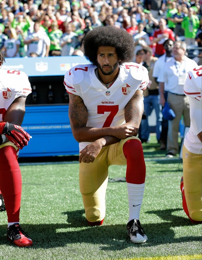 Not the first American to stage a peaceful protest during our national anthem, San Francisco 49ers' Colin Kaepernick kneels during the song before a 2016 NFL game in Seattle.