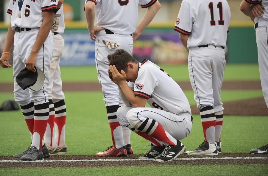 Huntley's Evan Tocmo reacts after the Red Raiders' 4-3 loss to Plainfield North in the Class 4A state baseball championship game at Route 66 Stadium in Joliet on Saturday.
