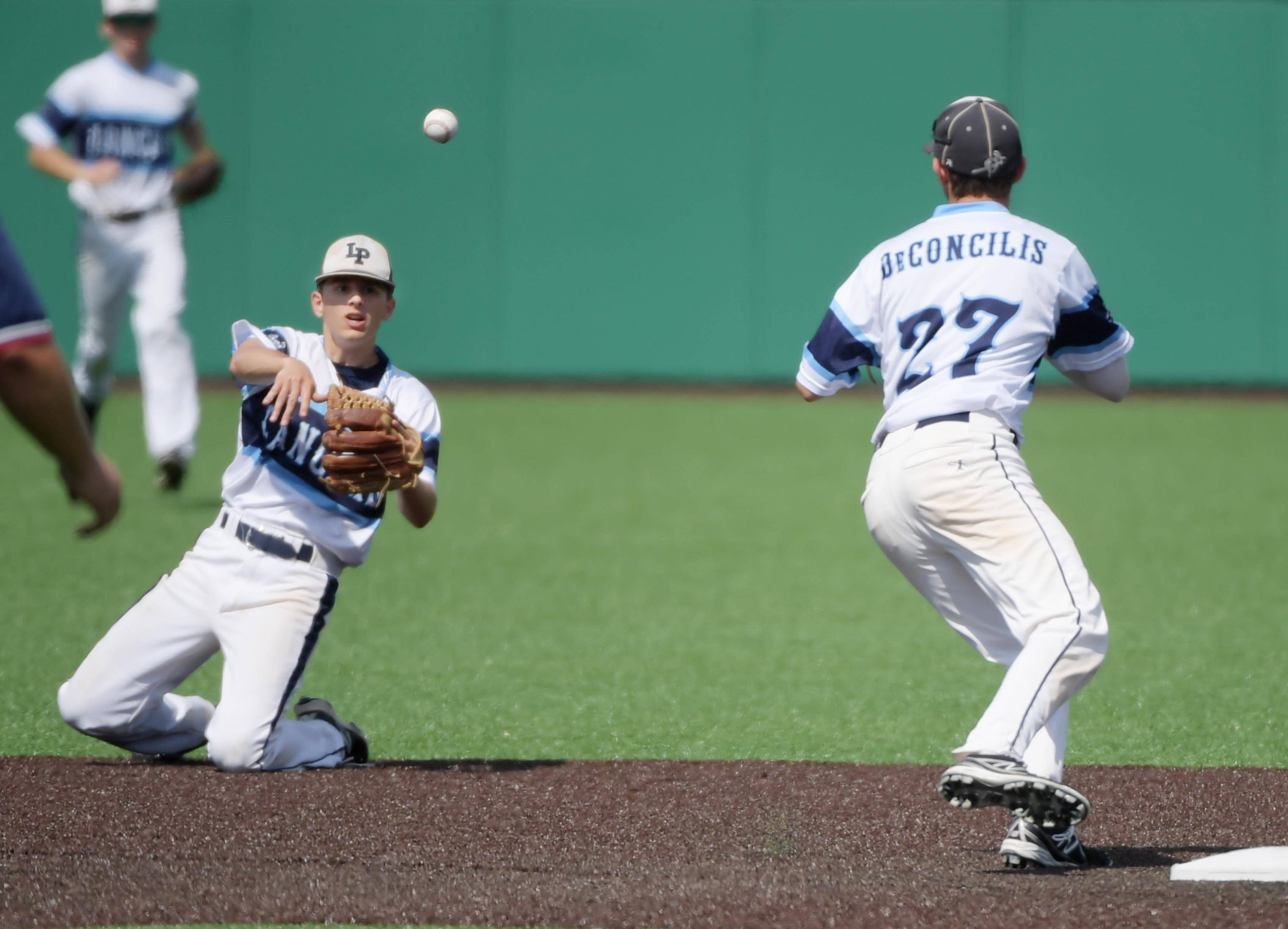 Lake Park second baseman John DeConcilis tosses the ball from his knees to his brother Anthony DeConcilis to force out Sandburg's Andrew Tenison to end the third inning in the Class 4A state baseball third place game at Route 66 Stadium in Joliet Saturday.