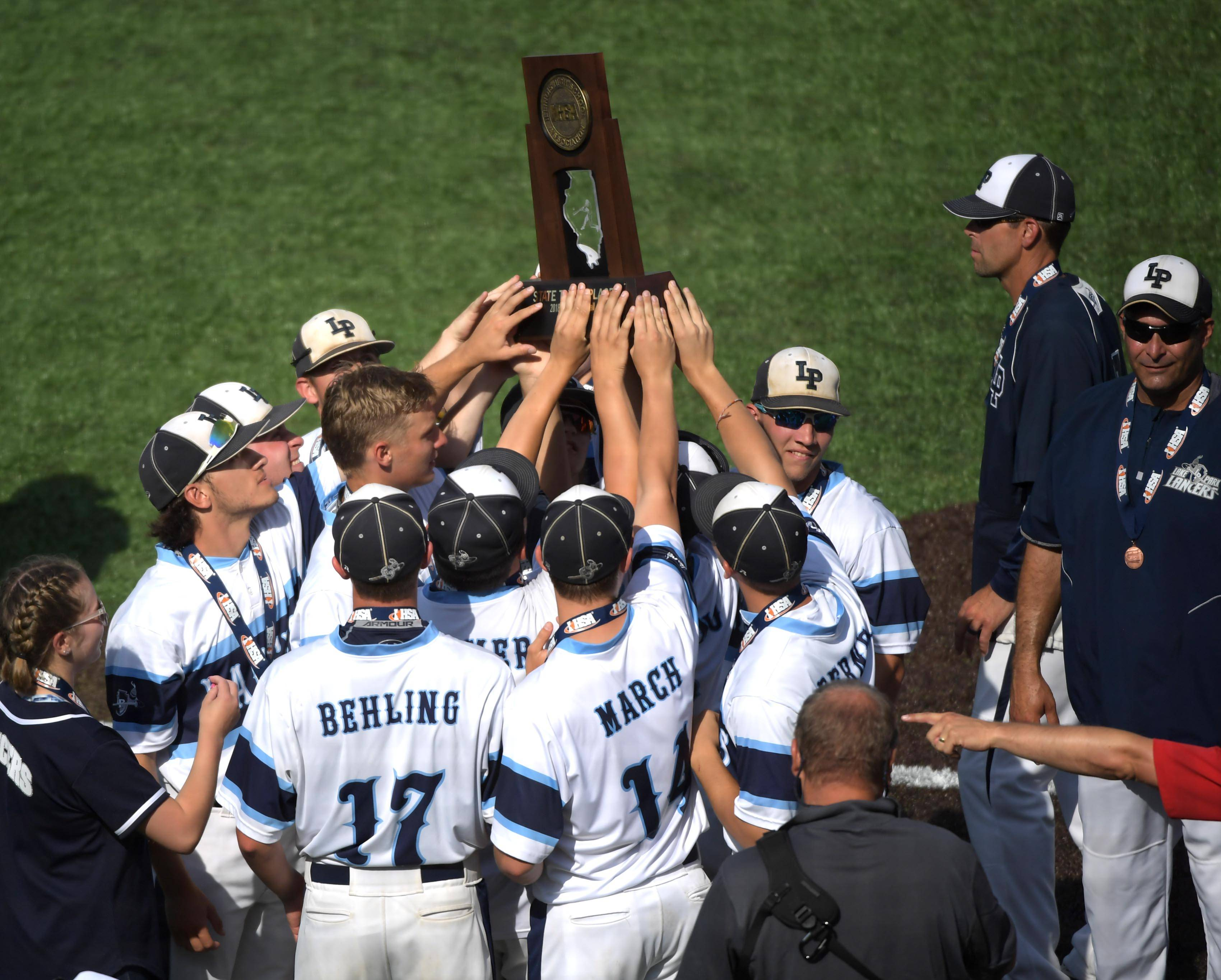 Lake Park holds it's third place trophy after defeating Sandburg in the Class 4A state baseball third place game at Route 66 Stadium in Joliet Saturday.