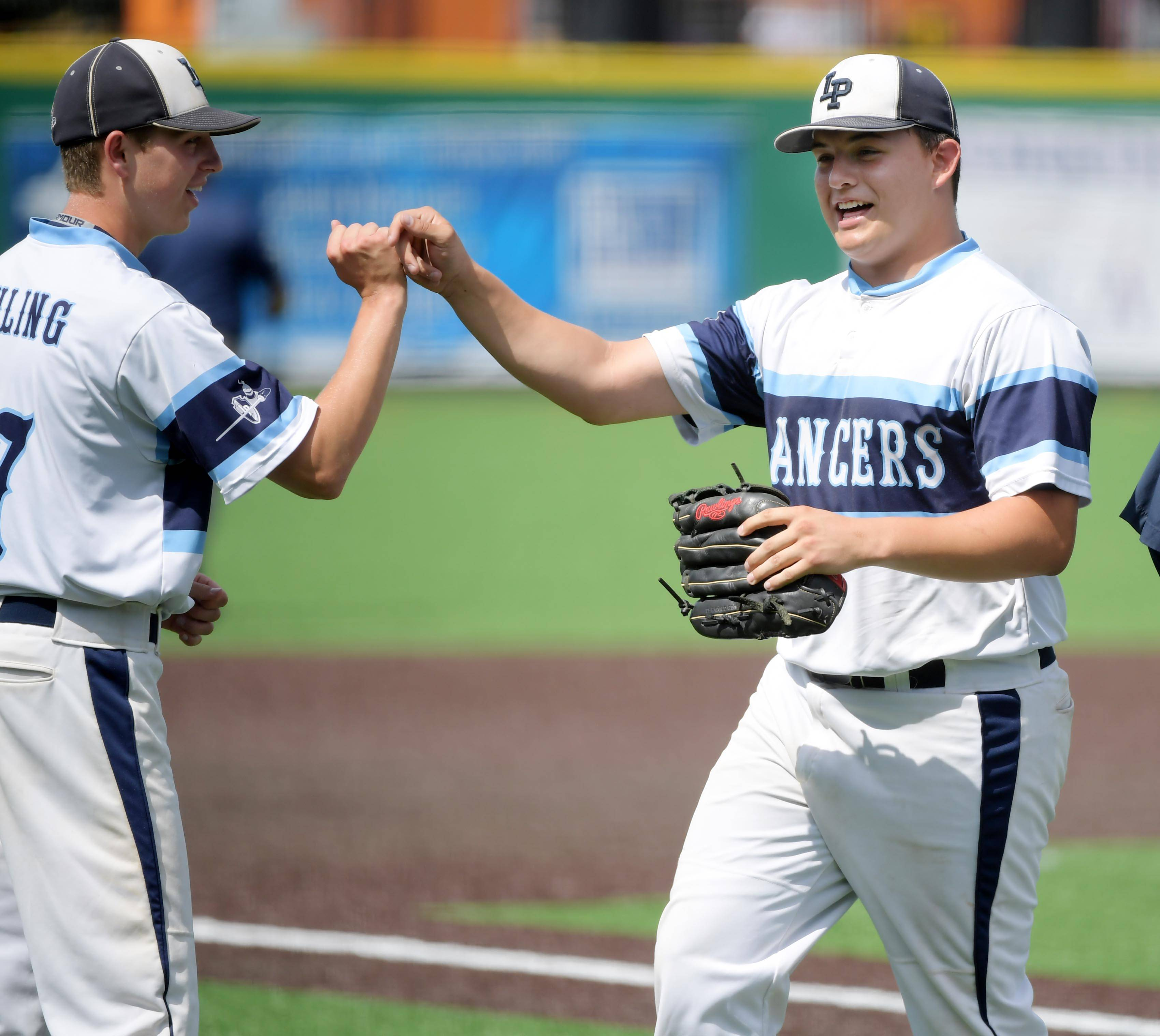 Lake Park pitcher Jay Palmer comes off the field after the first inning against Sandburg in the Class 4A state baseball third place game at Route 66 Stadium in Joliet Saturday.