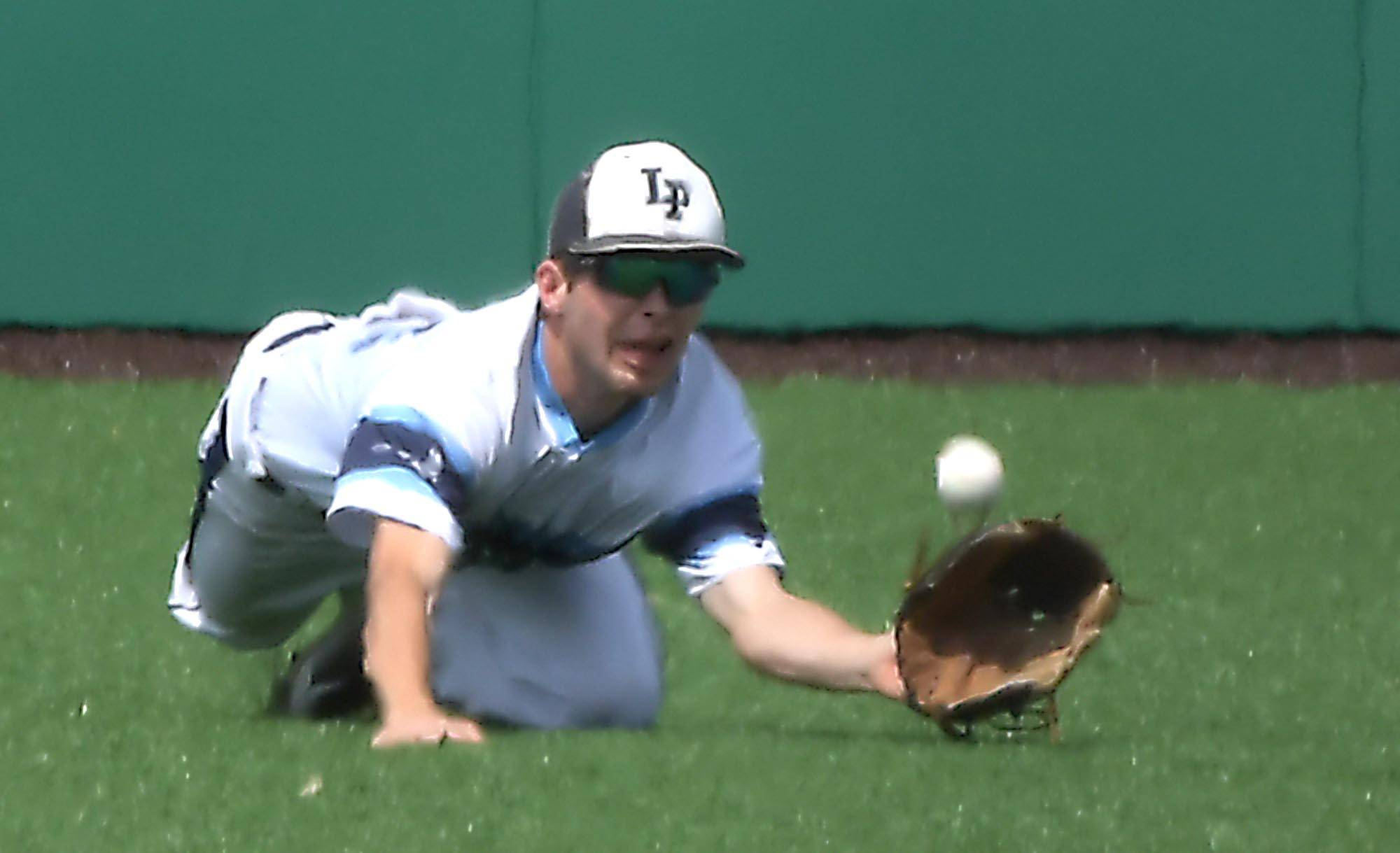 Lake Park centerfielder Eric Brown dives but misses a line drive base hit by Sandburg's Ryan Hampe in the first inning in the Class 4A state baseball third place game at Route 66 Stadium in Joliet Saturday.