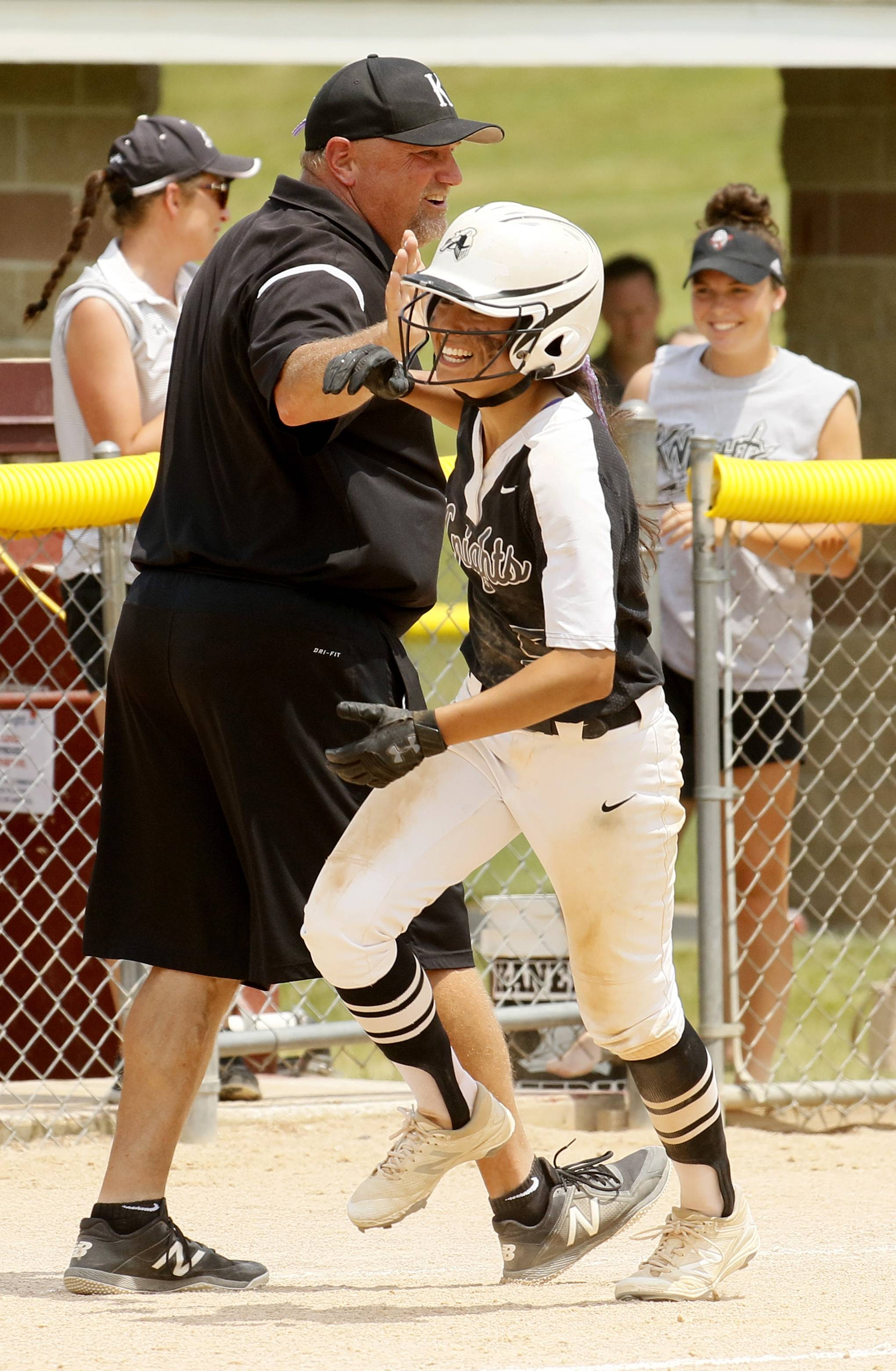 Kaneland's Donatela Sommesi rounds third base and is congratulated for hitting a home run against Montini Catholic.