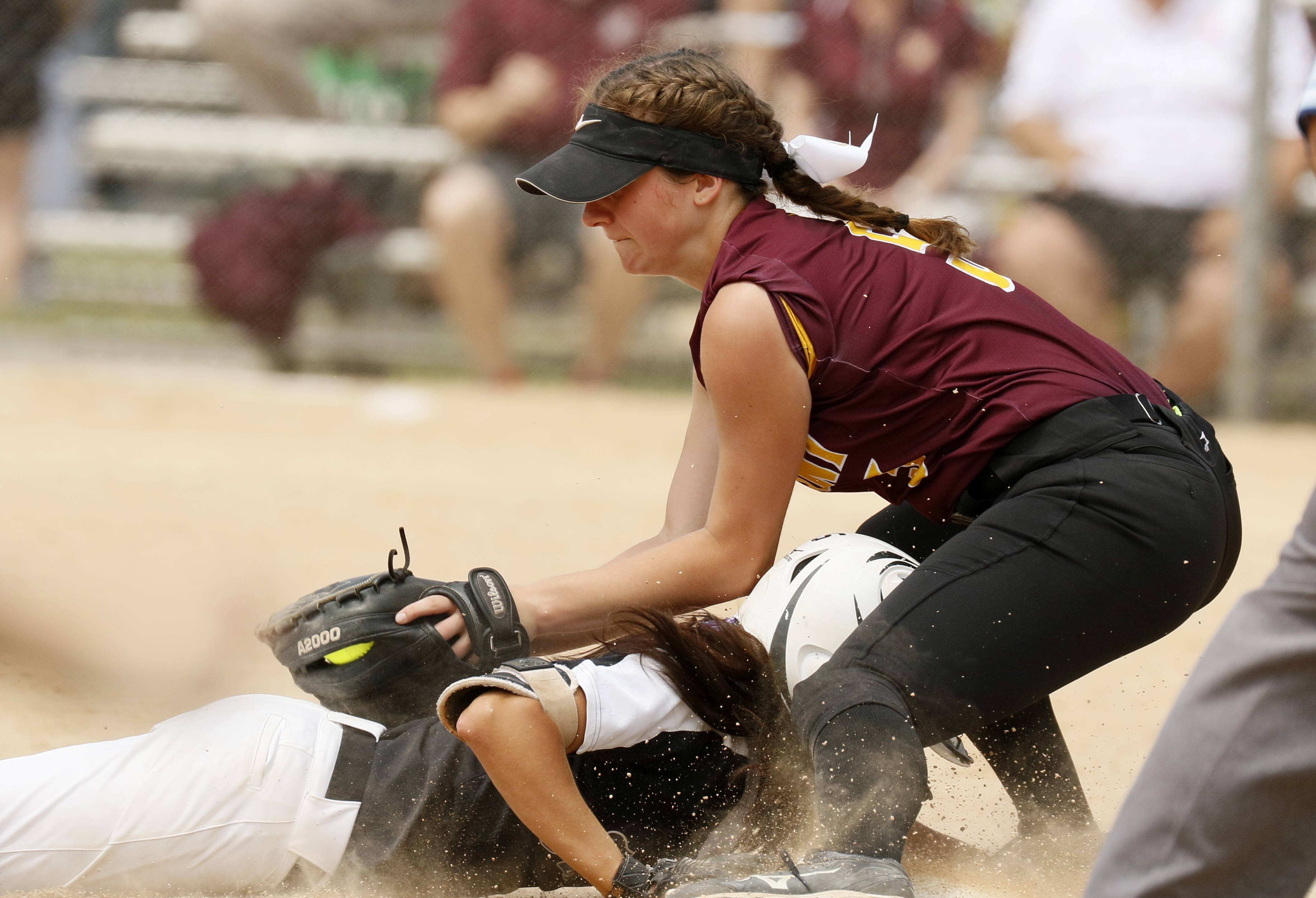 Kaneland's Donatela Sommesi slides safely into third base under the tag of Montini Catholic's Lauren Latoria   during the IHSA Class 3A state softball championship.