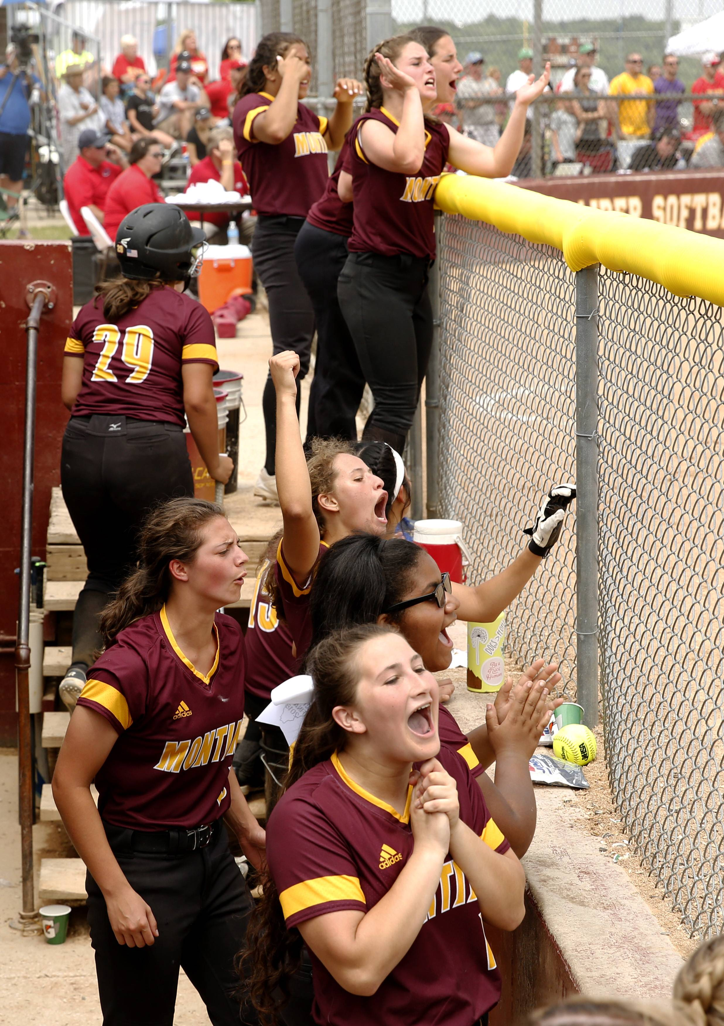 Montini Catholic players celebrate their epic 15-8 seventh inning comeback against Kaneland.