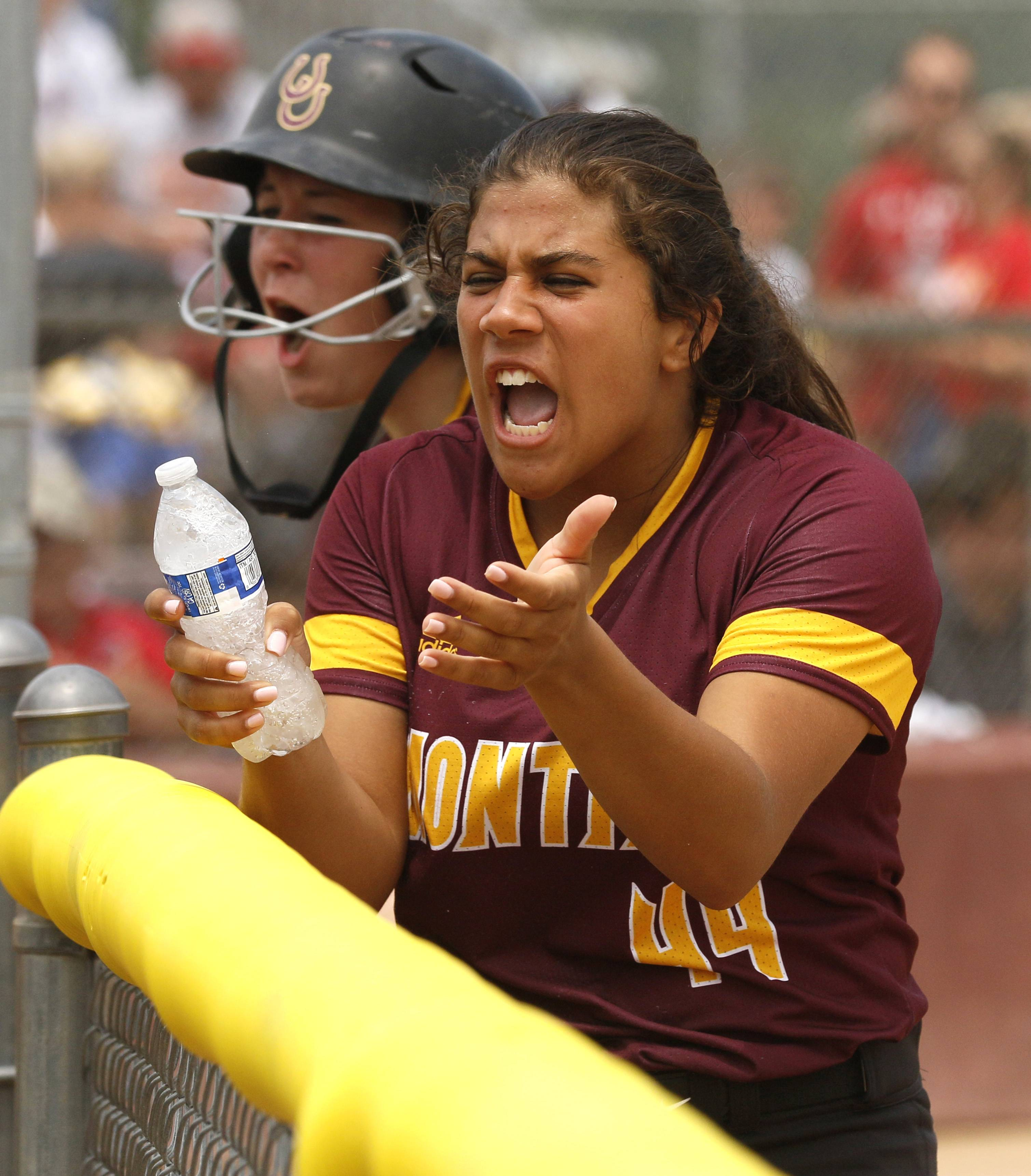 Montini Catholic pitcher Brianna Clifton encourages her team during a 12-run seventh inning against Kaneland.
