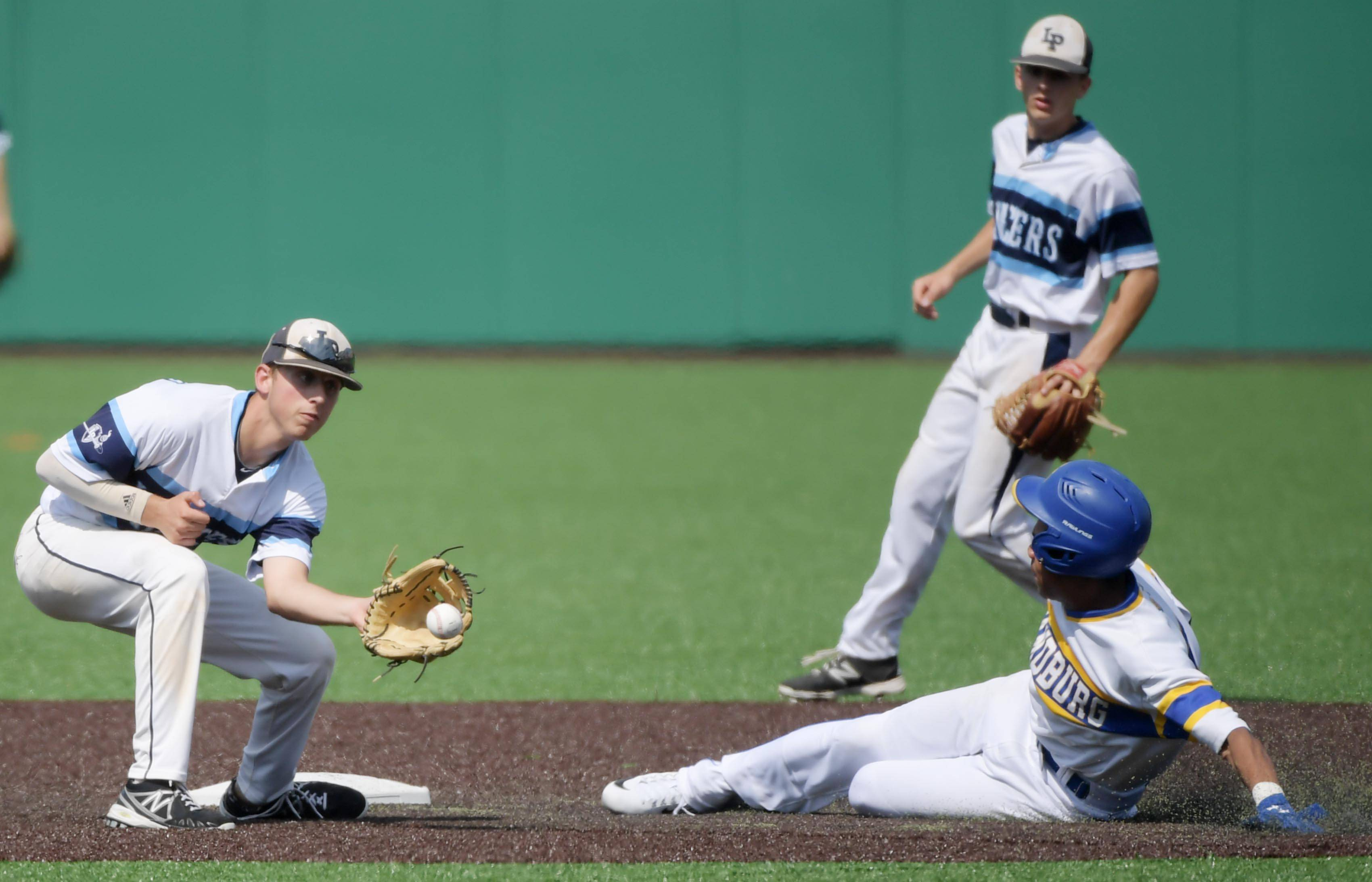 Lake Park's Anthony DeConcilis catches the throw from catcher Zach Aehlert as Sandburg's Ian Sanders steals second base in the Class 4A state baseball third place game at Route 66 Stadium in Joliet Saturday.