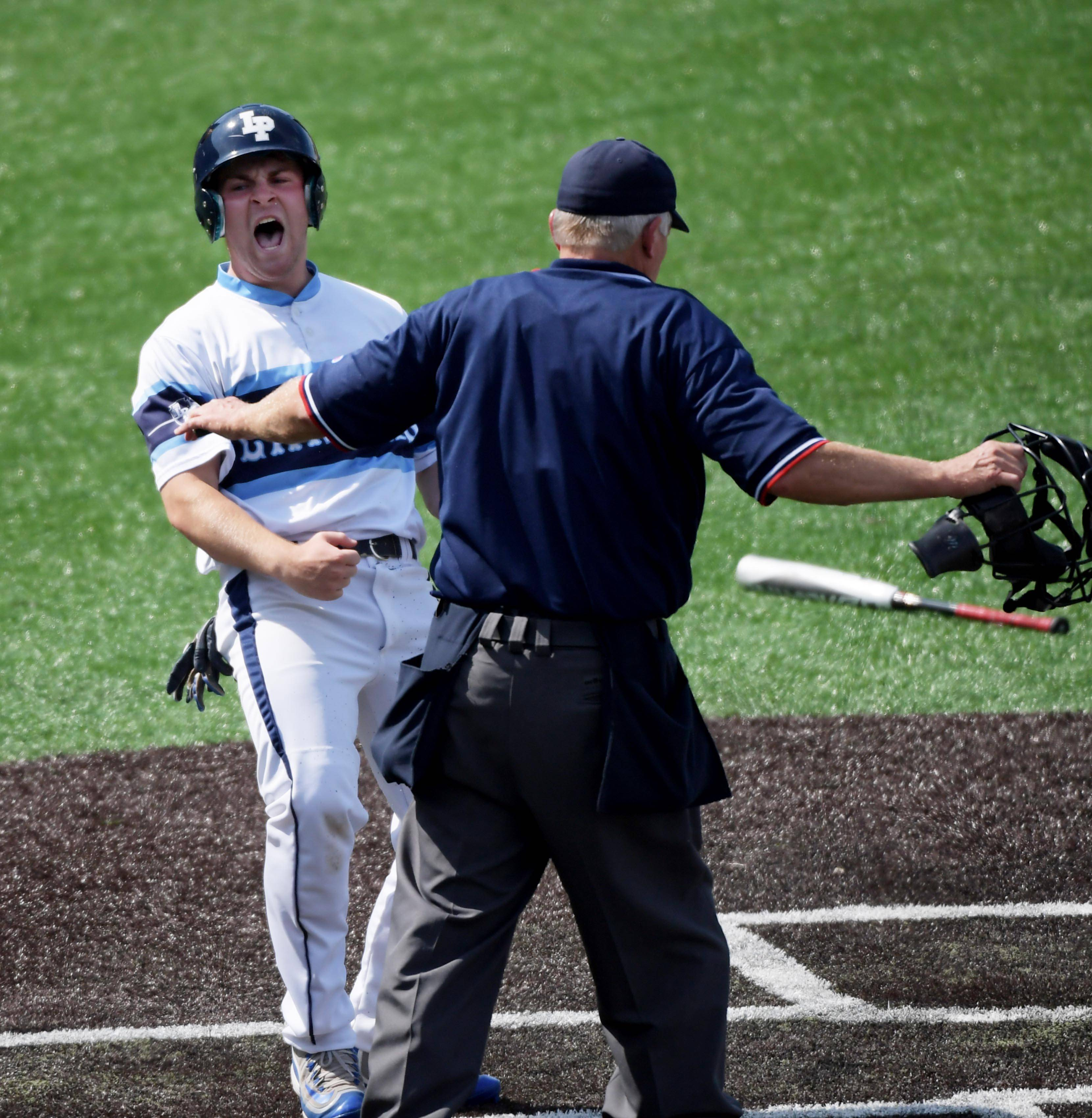 Lake Park's Anthony Baturin reacts after scoring against Sandburg in the Class 4A state baseball third place game at Route 66 Stadium in Joliet Saturday.