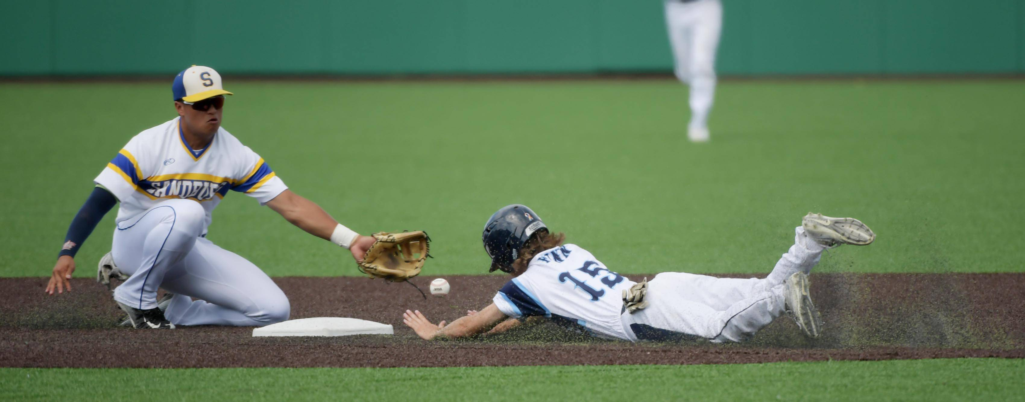 Lake Park's Tommy Finn steals second base as Sandburg's Branden Comia fields the ball in the Class 4A state baseball third place game at Route 66 Stadium in Joliet Saturday.
