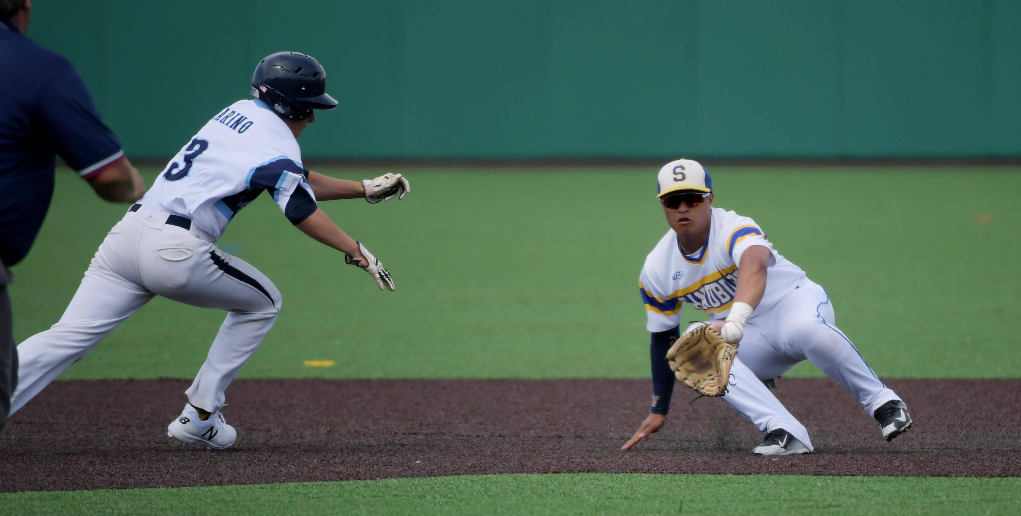Lake Park's Rory Marino gets caught off second base by Sandburg's Branden Comia in the Class 4A state baseball third place game at Route 66 Stadium in Joliet Saturday.