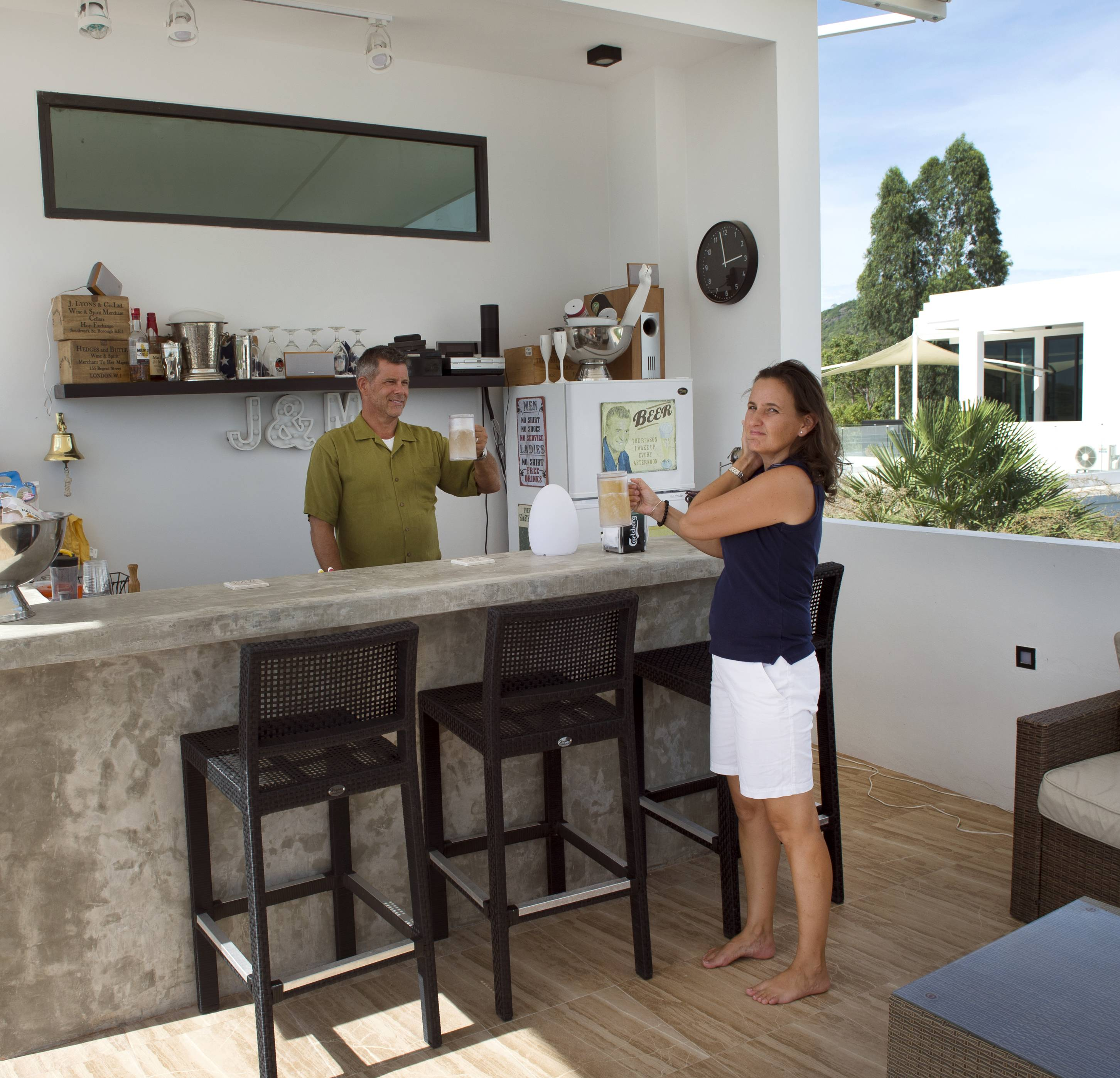 Jeffrey Camp and his wife Mari-Ann Kucharek Camp enjoy their rooftop bar area in Hua Hin, Thailand.
