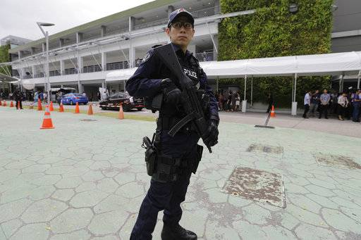 A police officer guards the entrance of the international media center Sunday, June 10, 2018, in Singapore ahead of the summit between U.S. President Donald Trump and North Korean leader Kim Jong Un on June 12.
