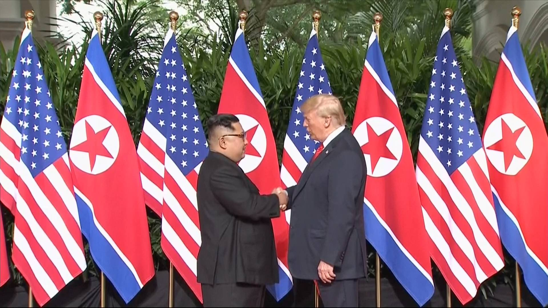 U.S. President Donald Trump and North Korean leader Kim Jong Un shake hands ahead of their meeting at Capella Hotel in Singapore, Tuesday local time.