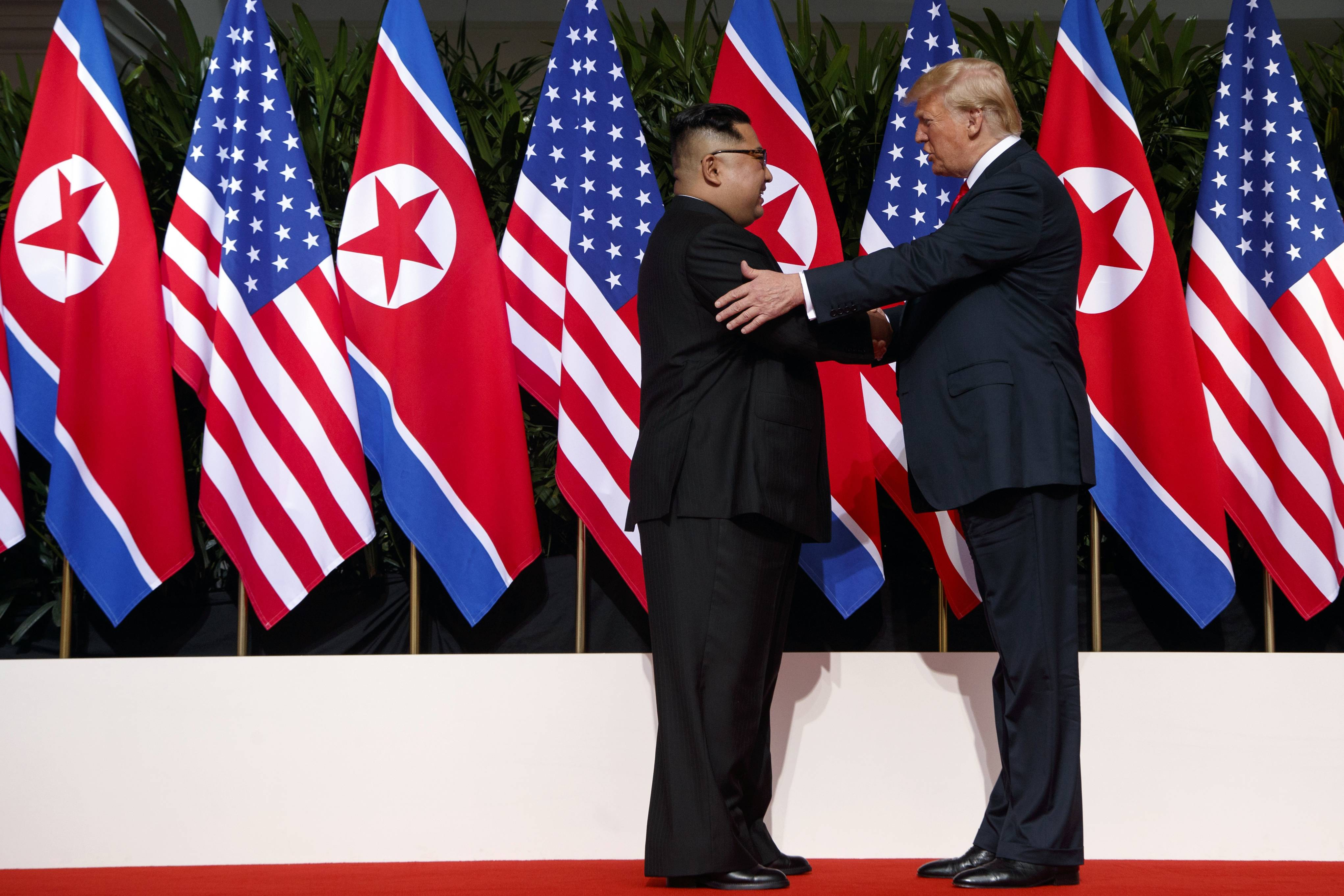 President Donald Trump meets with North Korean leader Kim Jong Un on Sentosa Island, Tuesday.