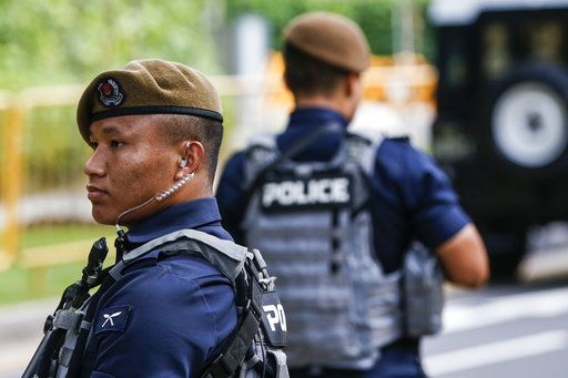 FILE - In this June 10, 2018, file photo, Gurkha police officers guard the perimeter of the Shangri-La Hotel in Singapore ahead of the summit between U.S. President Donald Trump and North Korean leader Kim Jong Un.