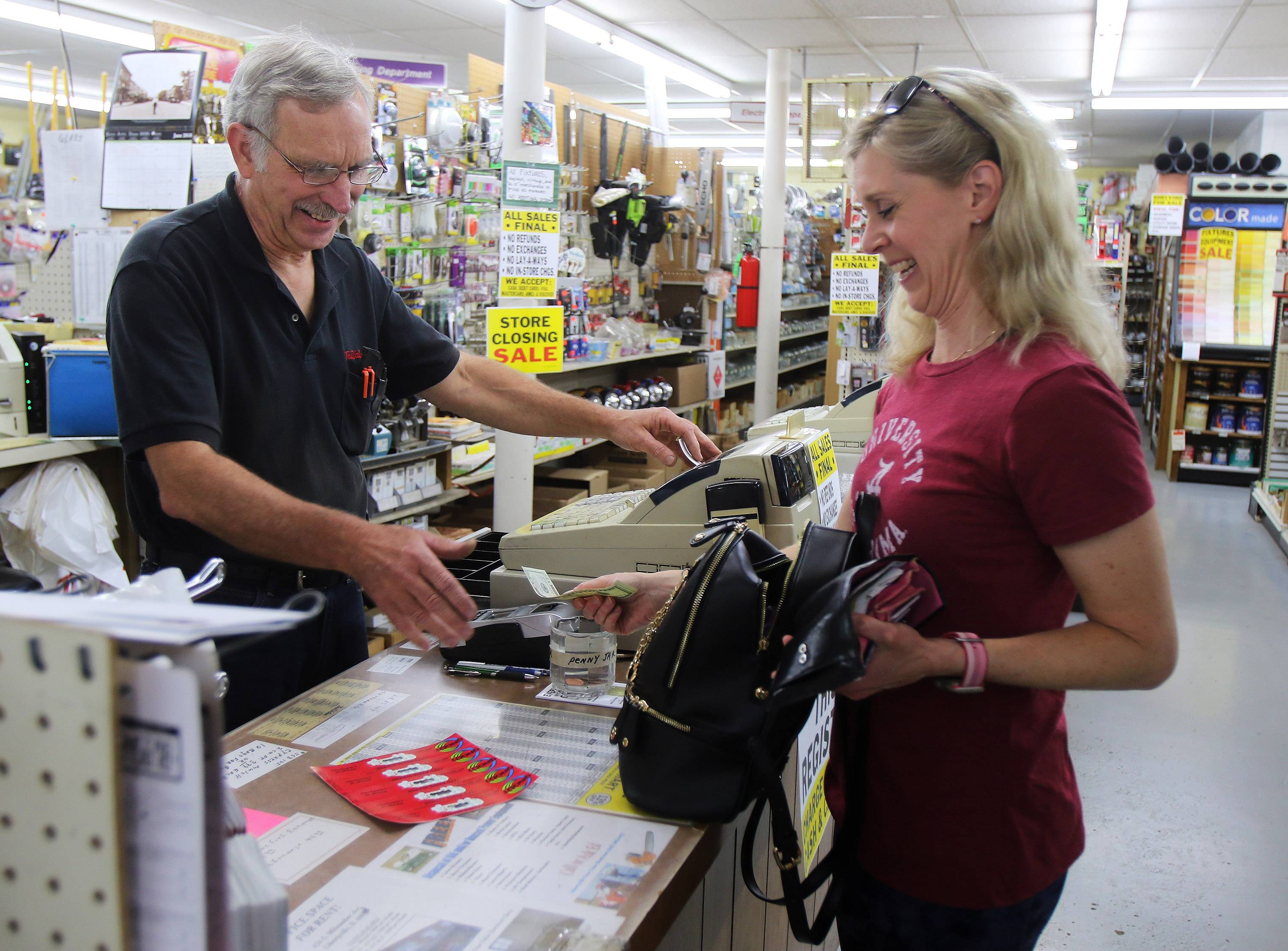Owner Ed LeJeune talks to customer Cindy Poland at the Libertyville True Value on Tuesday. The hardware store is closing and a liquidation sale begins Wednesday.