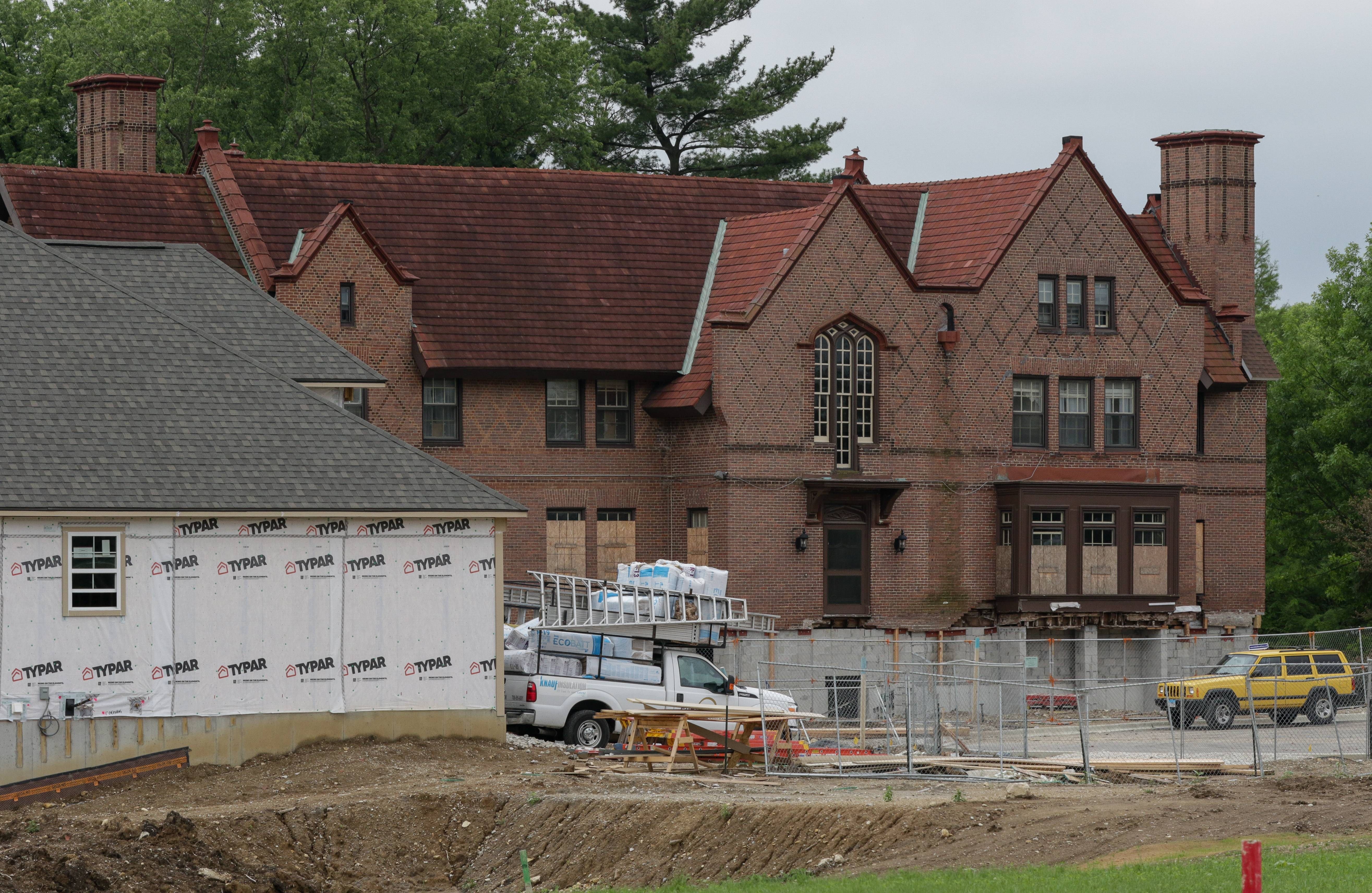 Bev Horne/bhorne@dailyherald.comConstruction continues around the foundation of the House of Seven Gables, a 19th-century mansion that was spared from demolition on the old Loretto Convent property in Wheaton.