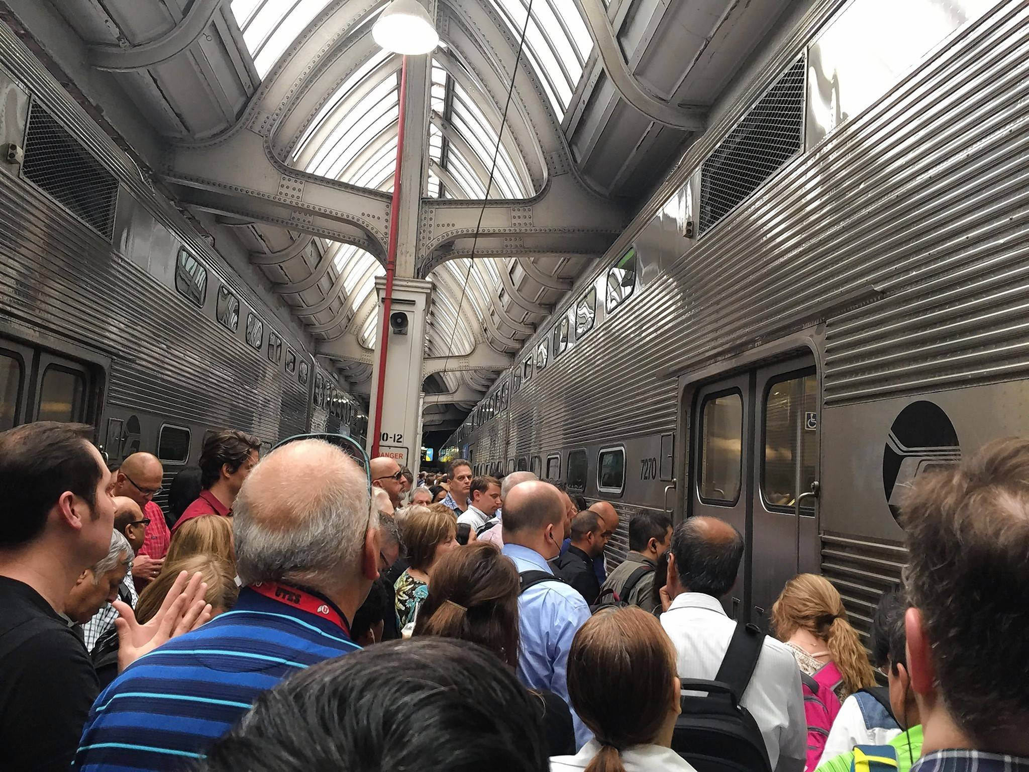 Metra BNSF passengers pack between trains at Union Station in Chicago to board Tuesday afternoon.