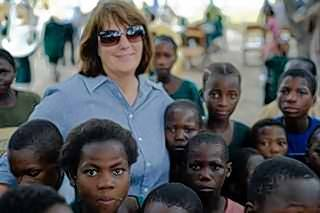 Vicky Wauterlek of Barrington, whose vision continues to drive the fair and its 250 volunteers, is the founder of Hands of Hope. Here, she is shown with children in Zambia, one of the latest targeted countries of the foundation.