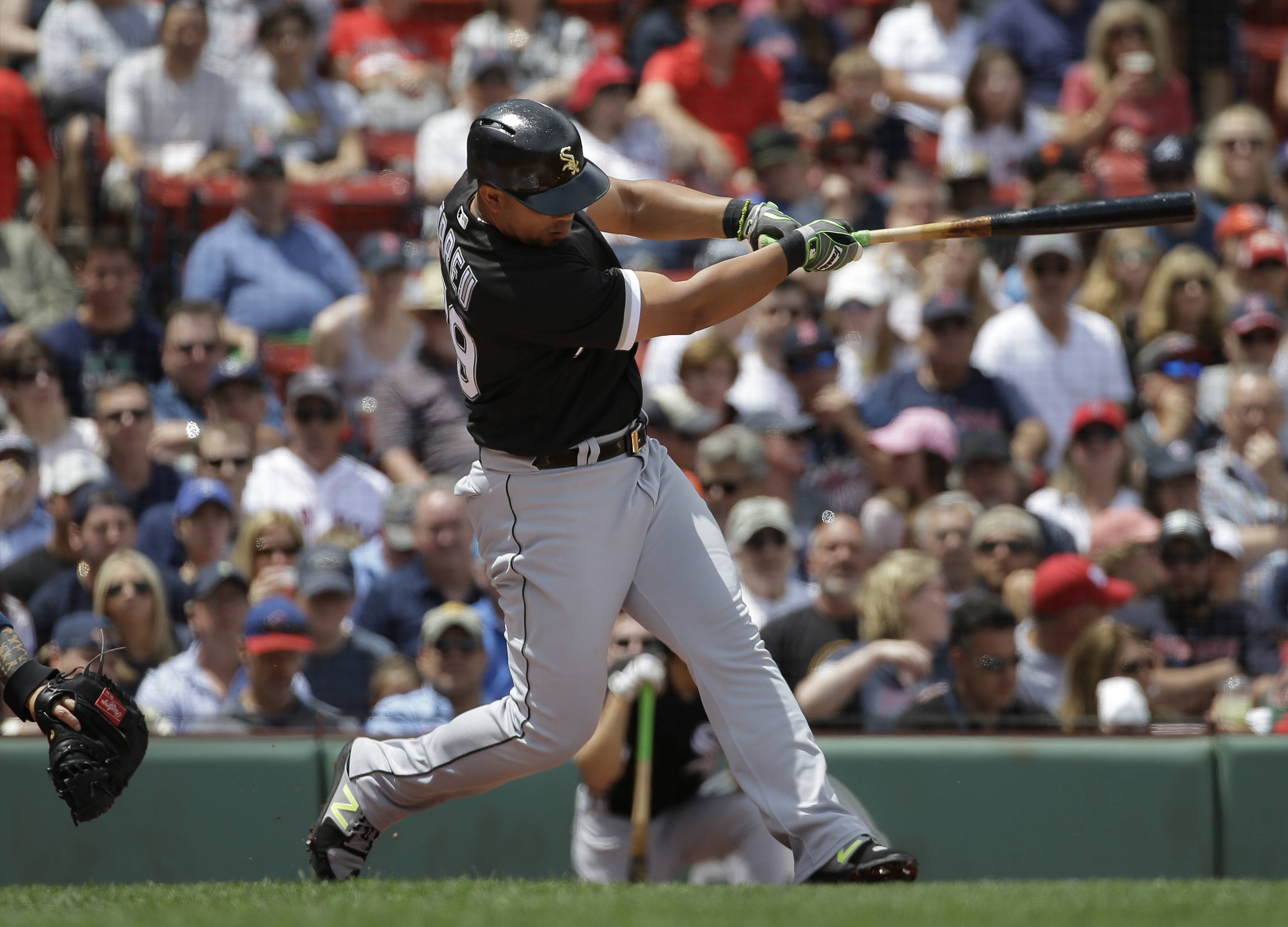 Chicago White Sox's Jose Abreu hits an RBI double in the first inning of a baseball game against the Boston Red Sox, Sunday, June 10, 2018, in Boston.