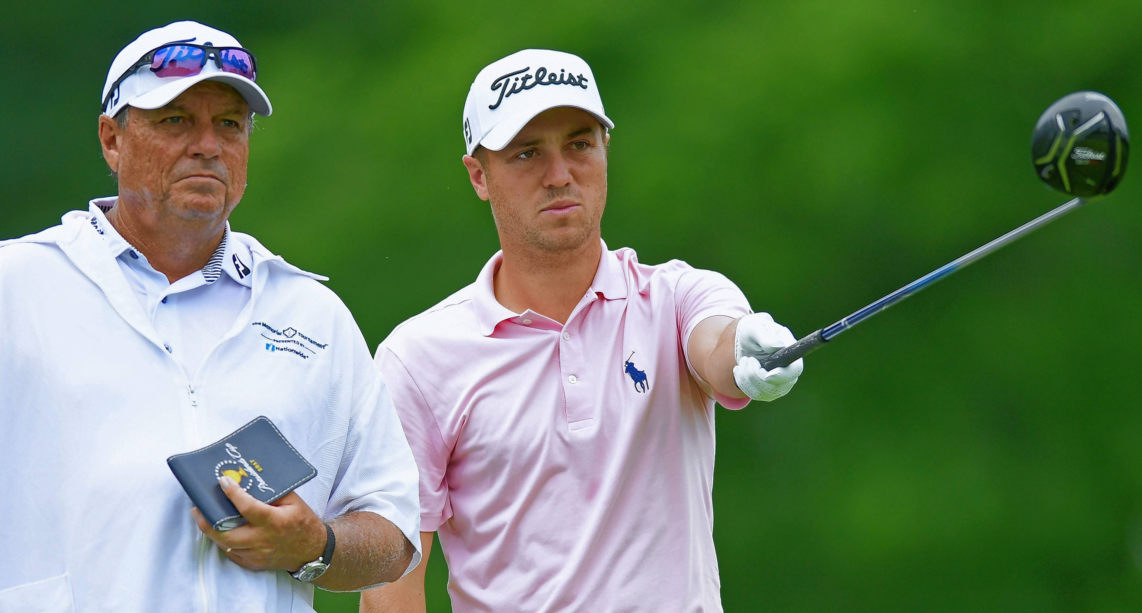 Justin Thomas, right, and his caddie, Jimmy Johnson, examine the fair way on the 18th hole during the third round of the Memorial golf tournament Saturday, June 2, 2018, in Dublin, Ohio.