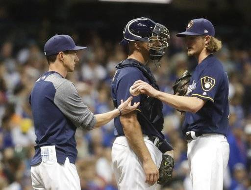 Milwaukee Brewers relief pitcher Josh Hader is taken out of the game during the eighth inning of a baseball game against the Chicago Cubs Monday, June 11, 2018, in Milwaukee.