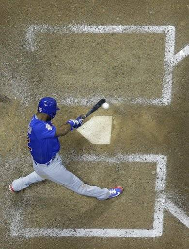 Chicago Cubs' Jason Heyward hits an RBI single during the eighth inning of a baseball game against the Milwaukee Brewers Monday, June 11, 2018, in Milwaukee.