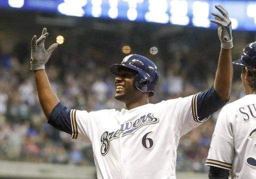 Milwaukee Brewers' Lorenzo Cain reacts after making it back to first on a rundown during the third inning of a baseball game against the Chicago Cubs Tuesday, June 12, 2018, in Milwaukee.
