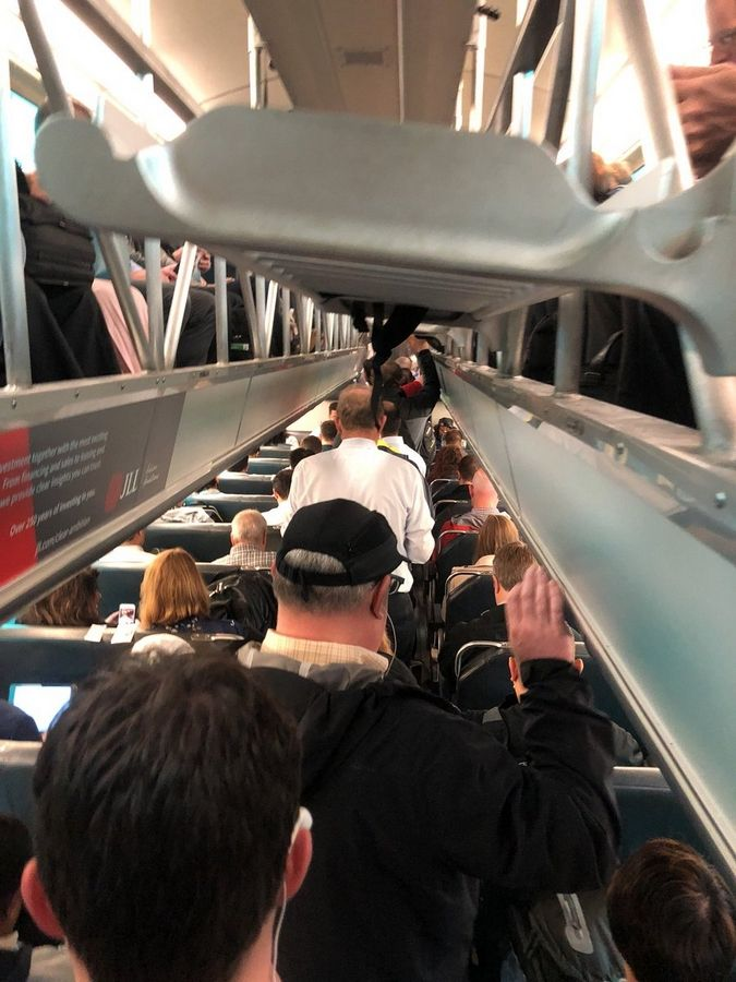 An inbound BNSF Line Metra train was packed with people on Monday, forcing some to stand for their commute from the suburbs.