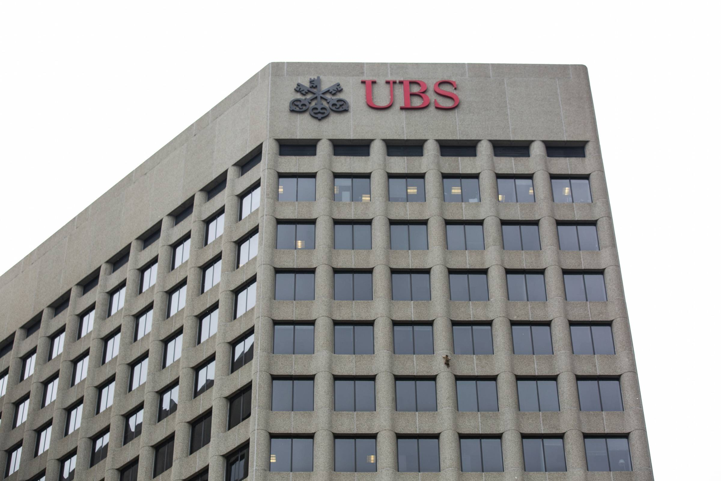A raccoon scales the side of the UBS Tower in downtown St. Paul.