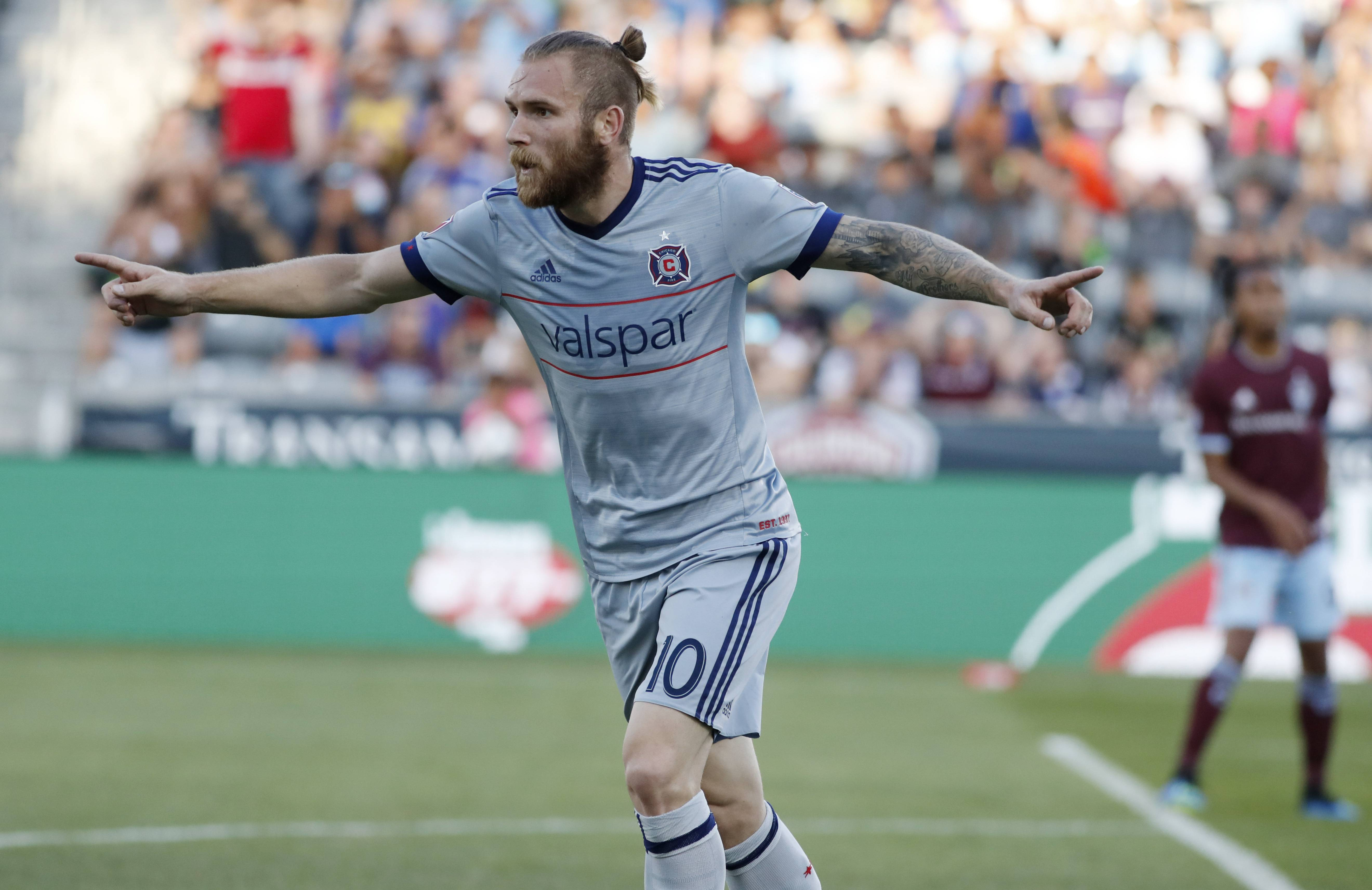 Chicago Fire forward Aleksandar Katai reacts after scoring a goal past Colorado Rapids goalkeeper Tim Howard during the first half of an MLS soccer match Wednesday, June 13, 2018, in Commerce City, Colo.