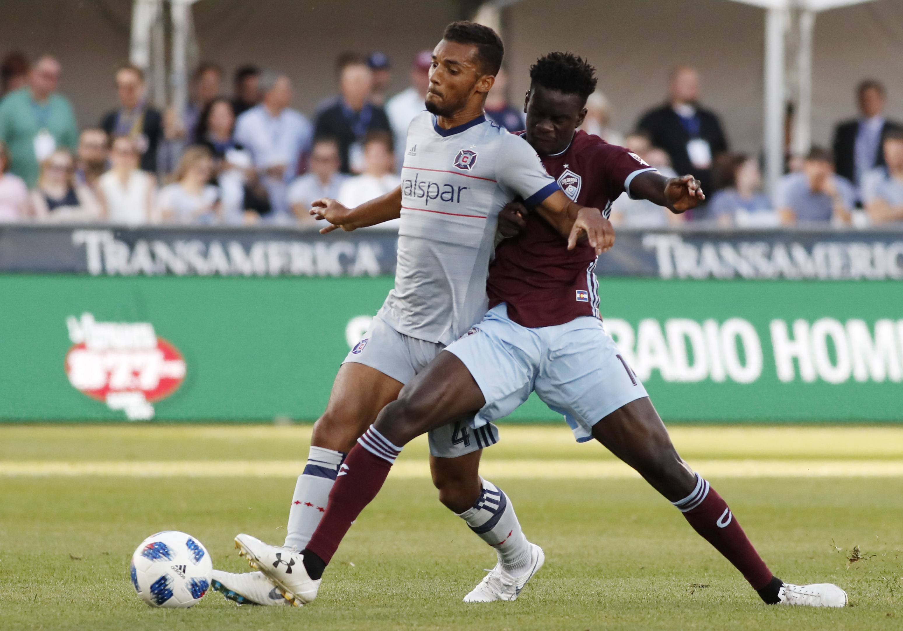 Colorado Rapids forward Dominique Badji, right, competes for control of the ball with Chicago Fire defender Johan Kappelhof during the first half of an MLS soccer match Wednesday, June 13, 2018, in Commerce City, Colo.