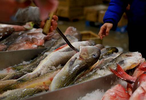 A fishmonger pulls tilefish for a buyer at the New Fulton Fish Market in New York on Monday, Jan. 8, 2018. The U.S. seafood industry is worth $17 billion a year, more than 90 percent of which is made up of imports.