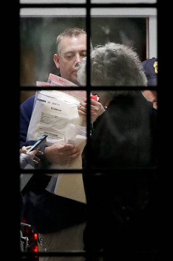 Federal agents gather documents for evidence during a raid on Gosman's Dock in Montauk, N.Y., on Wednesday, Dec. 6, 2017. Sea To Table's supplier in Montauk, N.Y., the Bob Gosman Company, has been cited in recent years for violating federal regulations relating to tuna imports. Separately, agents wearing body armor raided their offices on Dec. 6, seizing computers and paperwork. It is not clear if charges were filed.