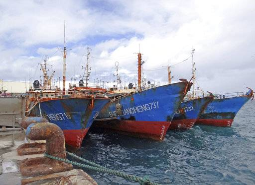Luen Thai Fishing Venture boats are docked at the Majuro port in the Marshall Islands on Feb. 1, 2018. Luen Thai is one of the companies that was supplying fish that entered the supply chain of Sea To Table. Men work around the clock, getting little pay.