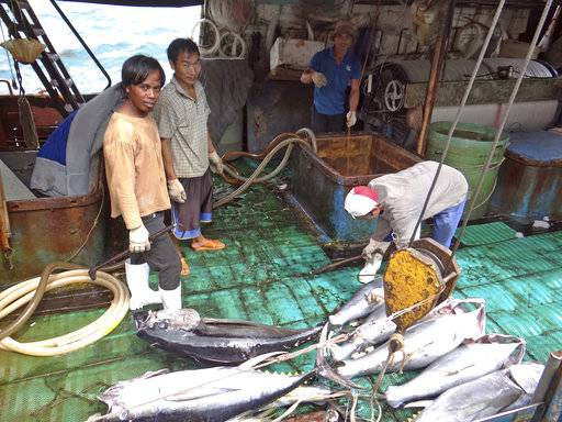 Fishermen at the Majuro port in the Marshall Islands unload yellowfin tuna on Feb. 1, 2018, for Luen Thai Fishing Venture, one of the companies that was supplying fish that entered the supply chain of Sea To Table. Men work around the clock, getting little pay.