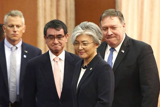 U.S. Secretary of State Mike Pompeo, right, attends a meeting with South Korean Foreign Minister Kang Kyung-wha, second from right, and Japanese Foreign Minister Taro Kono, second from left, at Foreign Ministry in Seoul, South Korea, Thursday, June14, 2018. (Chung Sung-Jun/Pool Photo via AP)