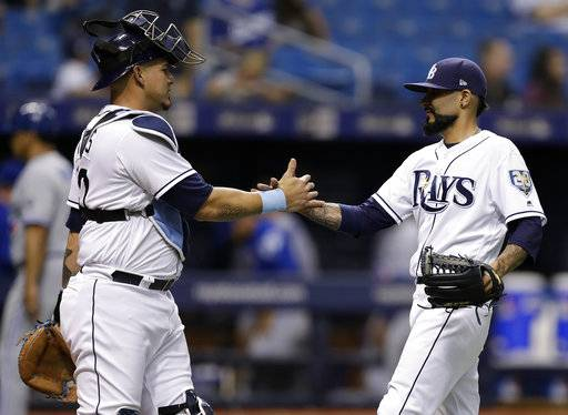 Tampa Bay Rays pitcher Sergio Romo and catcher Wilson Ramos celebrate after the Rays defeated the Toronto Blue Jays 4-1 in a baseball game Tuesday, June 12, 2018, in St. Petersburg, Fla.