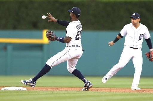 Detroit Tigers second baseman Niko Goodrum bare-hands the relay from shortstop Jose Iglesias, right, for a force on Minnesota Twins' Bobby Wilson on a ball hit by Eddie Rosario during the fifth inning of a baseball game,Wednesday, June 13, 2018, in Detroit.