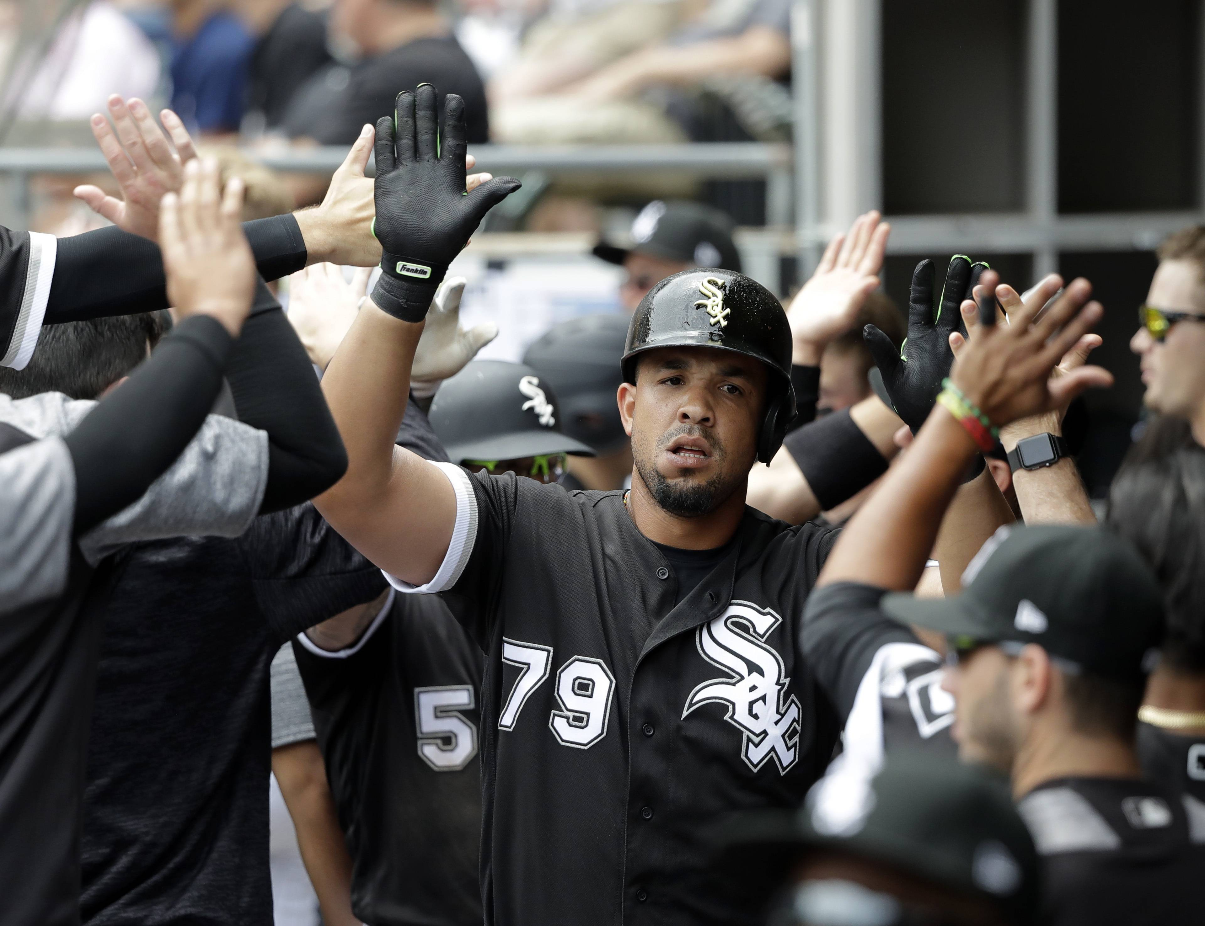 Chicago White Sox's Jose Abreu (79) celebrates in the dugout his two-run home run off Cleveland Indians starting pitcher Mike Clevinger during the first inning of a baseball game Thursday, June 14, 2018, in Chicago. Yolmer Sanchez also scored.