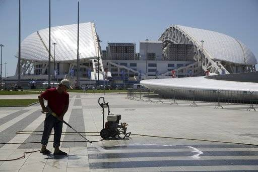 A worker cleans the area in front of Fisht Stadium ahead of the 2018 soccer World Cup in Sochi, Russia, on Thursday, June 14, 2018.
