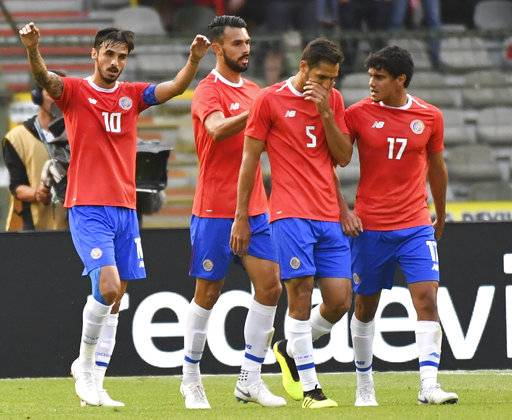Costa Rica's Bryan Ruiz, left, jubilates with teammate Costa Rica's Bryan Oviedo after scoring his sides first goal during a friendly soccer match between Belgium and Costa Rica at the King Baudouin stadium in Brussels, Monday, June 11, 2018.